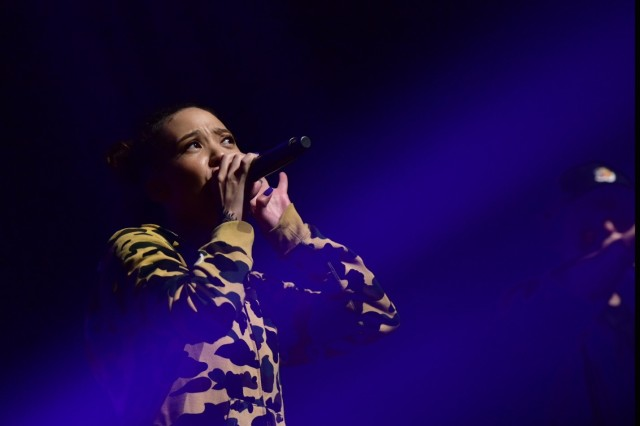 "UIJEONGBU, Republic of Korea -- Yoon Mi-Rae, a native of Fort Hood, Texas, and K-Pop music artist, performs her hit song ""Black Happiness"" during the Uijeongbu City Friendship and Respect Concert commemorating the long-standing partnership at the Arts Center Oct. 15. Yoon recalled being raised on Camp Red Cloud while her father was in the service."