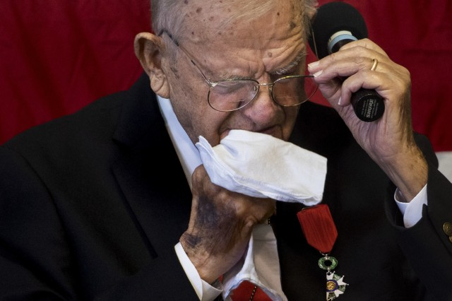 "Walter Pruiksma wipes tears from his eyes during the song ""God Bless America"" at his Order of the Marechaussee award ceremony, Oct. 13, 2018 Mannasquan, N.J."