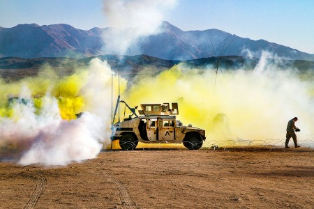 Soldiers with 56th Stryker Brigade Combat Team, 28th Infantry Division, Pennsylvania Army National Guard, endure a CS gas attack at the National Training Center, Fort Irwin, Calif., Aug. 17, 2018, putting their chemical, biological, radiological and Nuclear defense training to use during the early morning surprise attack.