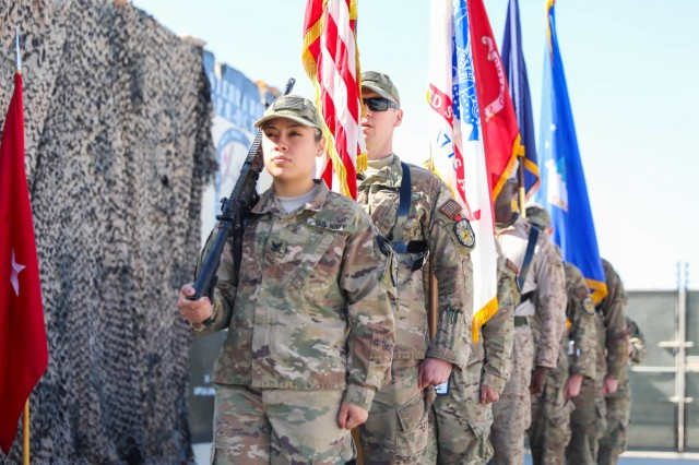 KANDAHAR, AIRFIELD, Afghanistan - Service members from the U.S. Navy, U.S. Army, U.S. Air Force and U.S. Marine Corps present the nations colors, Oct. 14, 2018, during a transfer of authority ceremony in Kandahar Airfield, Afghanistan. The ceremony bid farewell to the U.S. Navy's Sierra rotation and welcomed Tango rotation to Kandahar Airfield and the NATO Role III Multinational Medical Unit. (U.S. Army photo by Staff Sgt. Neysa Canfield)