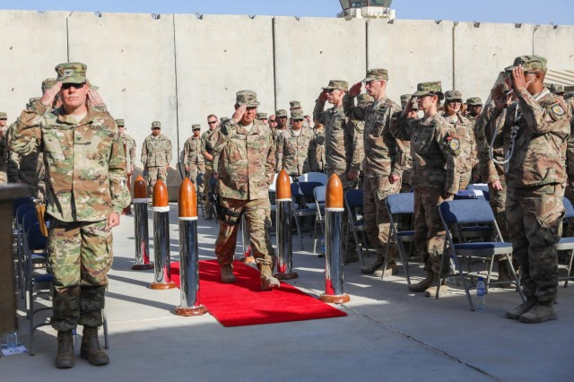 KANDAHAR, AIRFIELD, Afghanistan -U.S. Navy Capt. David Jones, incoming commander of NATO Role III Multinational Medical Unit, salutes the sideboys, Oct. 14, 2018, during a transfer of authority ceremony in Kandahar Airfield, Afghanistan. Jones took authority of Role III from U.S. Navy Capt. Cynthia Gantt during the ceremony. (U.S. Army photo by Staff Sgt. Neysa Canfield)