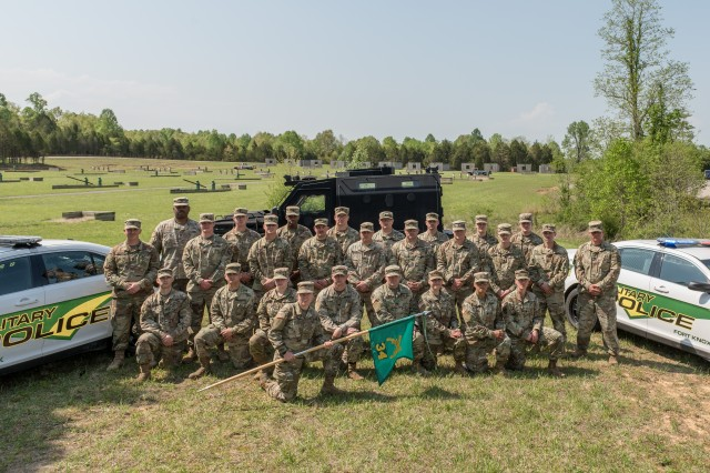 Fort Knox Military Police from the 34th MP Detachment pose for a unit photo at the grenade range on Fort Knox. The 34th Military Police Detachment commander attributes his Soldiers' commitment to community service - in and out of the uniform - as a factor in why his MP unit was named the most outstanding in U.S. Army Training and Doctrine Command for fiscal year 2018.