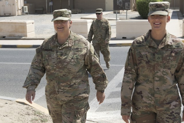 U.S. Army Maj. Lisa Van Horn, left, the chief of patient administration at the 452nd Combat Support Hospital, and her daughter, Pfc. Jenna Van Horn, a pharmacy specialist also with the 452nd Combat Support Hospital, walk to lunch together at Camp Arifjan, Kuwait, Oct. 3, 2018.