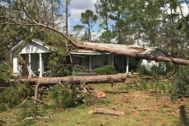 A joint patrol of Georgia Army and Air National Guard Soldiers and Airmen were flagged down by the resident of this heavily damaged home in Seminole County Oct 16, 2018 while delivering relief supplies. They provided ice, water and food and called 911 to provide emergency care.