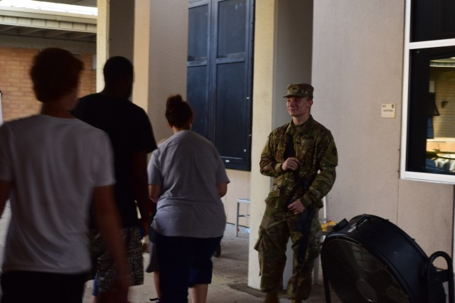 Spc. Thomas J. Kotvas, an ammunition specialist assigned to Co. A, 53rd Brigade Support Battalion, provides security to an American Red Cross shelter in Panama City, Fla, October 15, 2018.