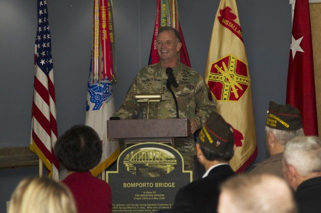 Maj. Gen. Walter E. Piatt, 10th Mountain Division (LI) and Fort Drum commander, addresses the audience at the USO during the Bomporto Bridge dedication ceremony Oct. 16 at Fort Drum, N.Y. (Photo by Spc. Charlotte Carulli, 27th Public Affairs Detachment)
