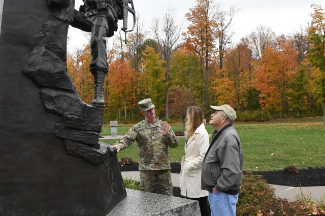 Maj. Gen. Walter E. Piatt, 10th Mountain Division (LI) and Fort Drum commanding general, shares some history at Memorial Park with Mary Ryan and her father Robert Huni during their visit Oct. 17 at Fort Drum, New York. (Photo by Mike Strasser, Fort Drum Garrison Public Affairs)