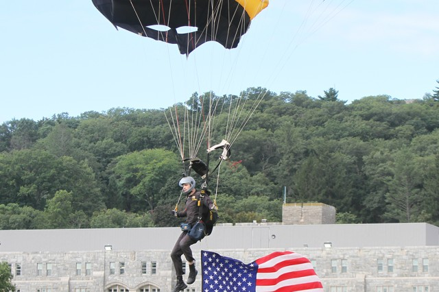 A member of the West Point Parachute team prepares to land on The Plain during a parade in September prior to an Army West Point Football game.