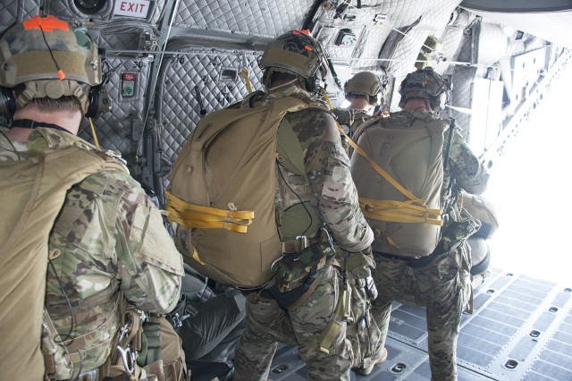 Jumpers preparing to exit Over the Ramp of the C-27J aircraft.