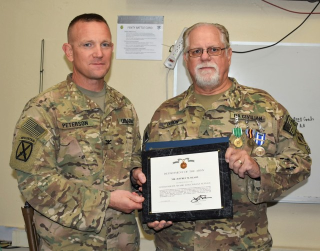 Olson honored for service