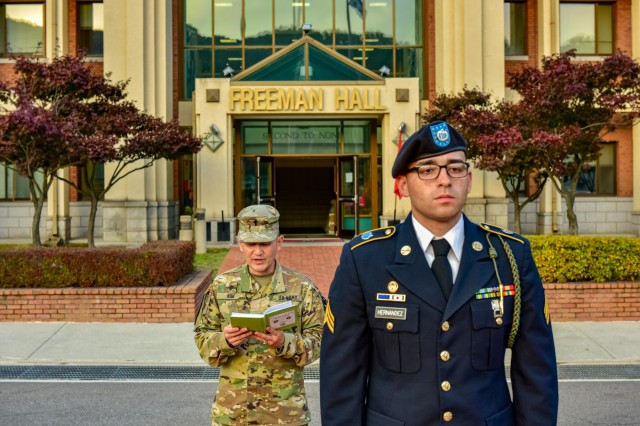 """CAMP RED CLOUD, Republic of Korea - Lt. Col. Hyeon-Joong """"Mike"""" Kim, a Seoul, Republic of Korea native and division chaplain, 2nd Infantry Division/ROK-U.S. Combined Division, says a prayer during the 2ID/RUCD's Freeman Hall closure ceremony Oct. 16. The 2nd Infantry Division/ROK-U.S. Combined Division's Freeman Hall closure ceremony marked the beginning of the final steps in the Warrior Division's transition to Camp Humphreys. (U.S. Army Photo by Mr. Pak, Chin U., 2ID/RUCD Public Affairs)"""