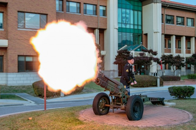 """CAMP RED CLOUD, Republic of Korea - A Soldier assigned to 2nd Infantry Division/ROK-U.S. Combined Division fires the canon at the start of the Army ceremonial evening song, """"To the Colors"""" during the 2ID/RUCD's Freeman Hall closure ceremony Oct. 16. The 2nd Infantry Division/ROK-U.S. Combined Division's Freeman Hall closure ceremony marked the beginning of the final steps in the Warrior Division's transition to Camp Humphreys. (U.S. Army Photo by Pfc. Park, Seung Ho, 2ID/RUCD Public Affairs)"""