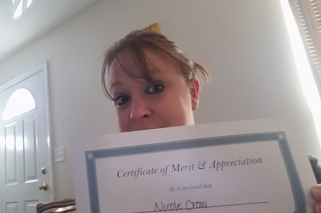 """Nicole Crow, a human resources assignment manager at Human Resource Command-Fort Knox, shows off her radiation graduation certificate. This day--graduating from cancer treatment-- was one of what Crow called her two best days during her fight. The other day was when she woke up from surgery and was told they, """"got all the cancer out."""""""