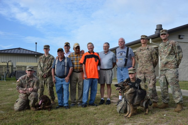 FORT BENNING, Ga. (Oct. 18, 2018) - Six Vietnam War veterans, who were former members of the 60th Infantry Platoon (Scout Dog) and who were accompanied by their Family members, visited Fort Benning Oct. 17 after almost 50 years to see how military working dogs were employed today. (U.S. Army photo by Bryan Gatchell, Maneuver Center of Excellence, Fort Benning Public Affairs)