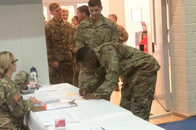 Maj. Sarah Ohm, Chief Nurse of Graf Health Army Health Clinic, screens Soldiers participating in a pandemic flu vaccination exercise at Grafenwoerh Oct. 1-5. The exercise tested the medical community's ability to respond to a real disease pandemic and rapidly immunize thousands of Soldiers.