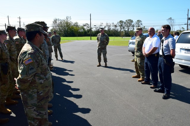 Donalsonville Fire and EMS Chief Dean King thanks Sgt. Blake Mote of the Kennesaw-based 190th Military Police Company for his actions on Oct. 17, 2018 when he assisted firefighters in suppressing a house fire in Seminole County, Ga. In his civilian capacity, Mote is a firefighter and advanced emergency management technician with the Clayton County Fire and Emergency Management Services. He and his unit have conducted relief operations in Dougherty and Seminole County, Ga. since October 11.
