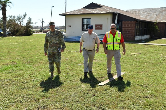 Col. Sebastien P. Joly, U.S. Army Corps of Engineers Mobile District commander, Wynne Fuller, Chief Operations Division Mobile District and Jonathan Carr, USACE Tyndall AFB resident engineer, assess the damage to the USACE Resident Office on Oct. 17, 2018, at Tyndall AFB, Va. Hurricane Michael's direct hit on Oct. 10, 2018 severely damaged the Tyndall AFB Resident Office. (USACE photo by Chuck Walker)