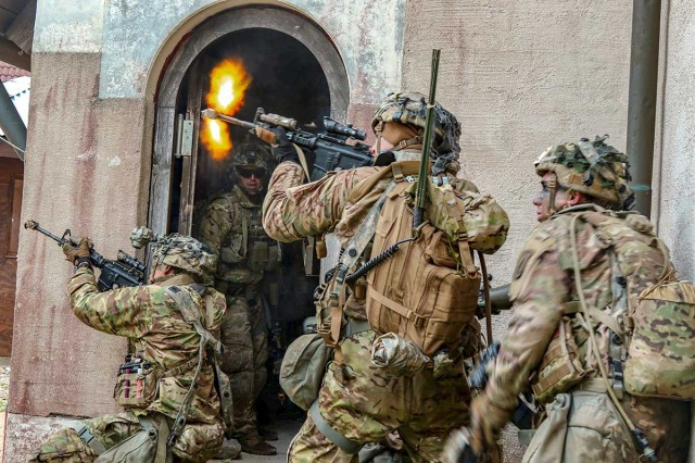 Soldiers with 503rd Infantry Regiment, 173rd Infantry Brigade Combat Team (Airborne), engage opposing forces in a simulated exercise during Saber Junction 18 at Hohenfels Training Area, Germany, Sept. 26, 2018.