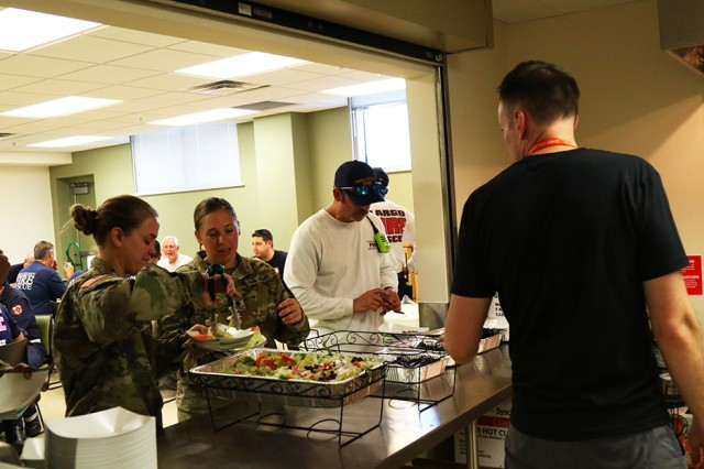 Florida National Guard Soldiers from the 53rd Brigade Support Battalion in Pinellas Park, Florida, serve themselves food provided by the World Central Kitchen, Oct. 14, 2018, in Panama City, Florida. The WCK is providing meals in response to Hurricane Michael to Guardsmen, first responders and those who were affected by the natural disaster.