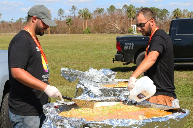 Yamil Lopez and Matt LeMasters, volunteers for the World Central Kitchen, make meals from paella pans, Mexico Beach, Florida, Oct. 14, 2018. Lopez, a Puerto Rico native, received help after Hurricane Maria in 2017 and came in response to Hurricane Michael to return the favor.