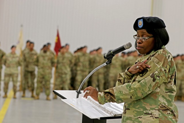 Outgoing Command Sgt. Maj. Octavia Greaves-Egyinam of the 10th Mountain Division Sustainment Brigade tearfully shows off her 10th Mountain patch as she addresses the formation for the final time on Friday, October 19, after relinquishing responsibility for the brigade. Greaves-Egyinam has served in the U.S. Army for 30 years and will retire later this month.