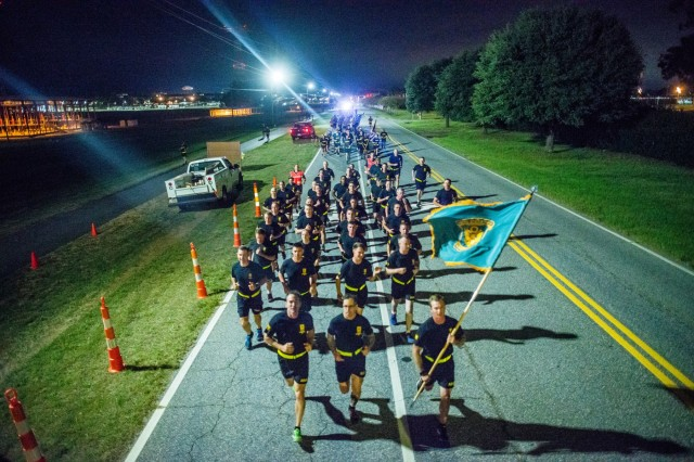 FORT BENNING, Ga. (Oct. 19, 2018) -- Maj. Gen. Gary Brito, commanding general of the U.S. Army Maneuver Center of Excellence, leads units from across post in an early morning run to celebrate the Fort Benning Centennial, Oct. 19, 2018. Fort Benning, formerly Camp Benning, was established Oct. 19, 1918 as a site to train Soldiers on Infantry skills and tactics. Today, the post provides trained and combat-ready Soldiers and leaders; develops the doctrine and capabilities of the maneuver force and individual Soldier; and provides a world-class quality of life for Soldiers, civilians and Army Families. (U.S. Army photo by Patrick A. Albright, Fort Benning Maneuver Center of Excellence photographer)