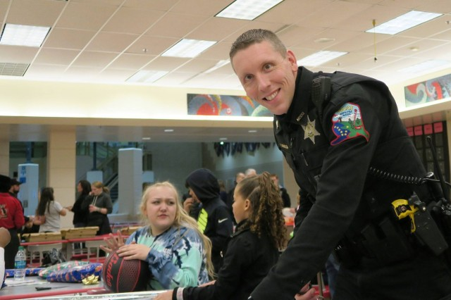 Officer Phillip McBroom at the annual Shop with a Cop holiday event in North Pole Alaska. McBroom is also a U.S. Army Reserve Chaplain and serves as the officer in charge of the 127th chaplain Detachment, 303rd Maneuver Enhancement Brigade, Fort Shafter, Hawaii.
