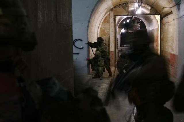 Soldiers at Fort Hood, clear an underground facility during dense urban environment training on Oct. 18. The training, provided by a mobile training team from 3rd Squadron, 16th Cavalry Regiment out of Fort Benning, introduces tactics and techniques to the force to prosecute operations within dense urban terrain and populated urban centers.