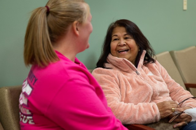 Madigan Army Medical Center patient Cresencia Aba talks to nurse Whitney Sutton after her screening at the hospital's 3rd annual breast cancer screening event on Oct. 20.