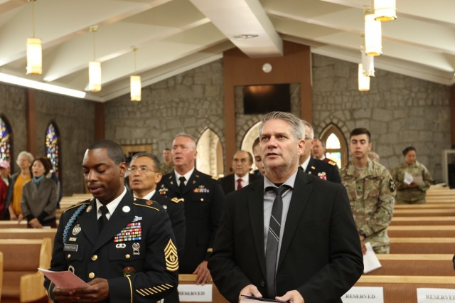 CAMP RED CLOUD, Republic of Korea -- Members of the community gather at the Warrior Chapel for the final service before that chapel closes its doors during the decommissioning ceremony Oct. 21. The functions and community services of the Warrior Chapel have relocated to U.S. Army Garrison Camp Humphreys, to continue serving the community members as it has for the past 66 years. The 2nd Infantry Division/ROK-U.S. Combined Division is in the process of returning Camp Red Cloud to the Korean government as a part of the transformation plan.