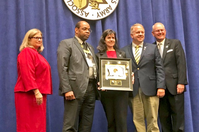 Federica LeMauk (center) is recognized as the European Association of the United States Army Region's Department of the Army Civilian of the Year during a ceremony in Washington, D.C.