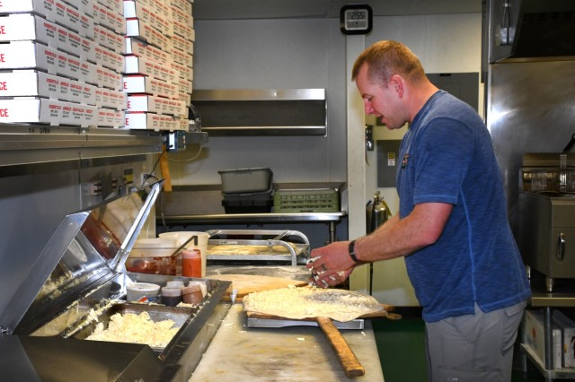 Idaho Army National Guard Sgt. Brian Padigimus prepares a pizza at Lucy's New York Style Pizzeria in Pocatello, Idaho, Sept. 19, 2018. Padigimus, an infantryman assigned to the 116th Cavalry Brigade Combat Team, started the pizza chain with a childhood friend in 2009.