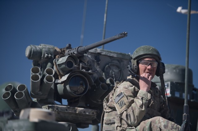 Lt. Col. Michael Berriman, squadron commander, 8-1 cavalry, 2-2 Stryker Brigade Combat Team, communicates to his command during a combined arms maneuver live-fire exercise at the Orchard Combat Training Center, Boise, Idaho, on Sept. 20, 2018. Army leaders plan to add laser technology to the Interim Maneuver Short-Range Air Defense System.