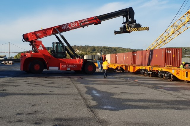 An ammunition container is loaded onto a French Commercial Railway Company railcar at the port of Radicatel, France. More than 170 containers were offloaded at the port, marking the first time in 50 years since the U.S. Army used a French port.