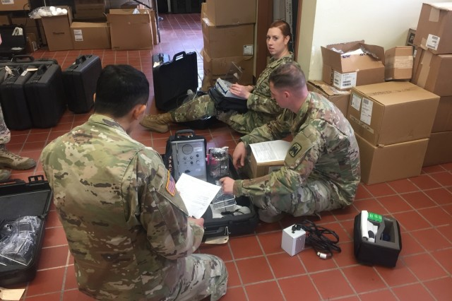 A group of Army Medical Logistics Specialists inspect and log medical equipment they received prior to issuing them to gaining units for use. Medical Logistics Specialists are tasked with keeping track of medical supplies and equipment. (Courtesy photo)