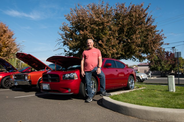 "Michael (Mike) Deccio, an engineering technician, stands with his Inferno Red 2006 Dodge, Charger that was one of the first in the assembly line. Mike is one of the 15 U.S. Army Corps of Engineers Walla Walla District employees who participated in the ""Wheels to Work"" day, on October 19, 2018, in Walla Walla, Washington."