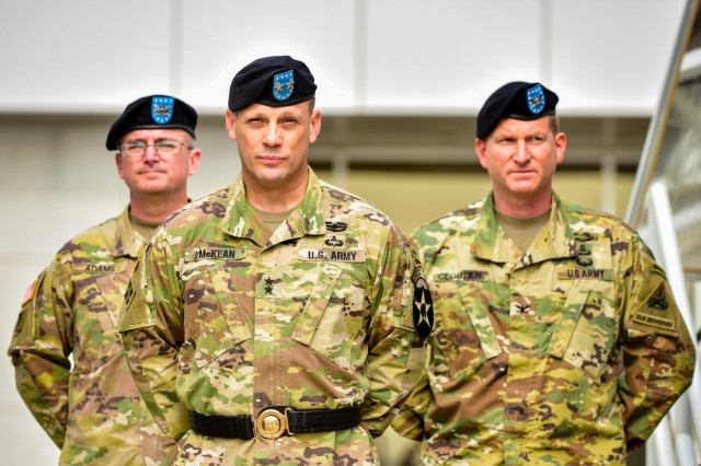 CAMP HUMPHREYS, Republic of Korea - Col. Mike Adams (Left), commander, 1st Armored Brigade Combat Team, 3rd Infantry Division; Maj. Gen. Scott McKean (Center), commander, 2nd Infantry Division/ROK-U.S. Combined Division; and Col. Marc Cloutier (Right), commander, 3rd Armored Brigade Combat Team, 1st Armored Division stand at parade rest during the transfer-of-authority ceremony between 1st Armored Brigade Combat Team, 3rd Infantry Division, and 3rd ABCT, 1st Armored Division. 3rd ABCT will serve as the new rotational tank brigade under the 2nd Infantry Division/ROK-U.S. Combined Division. This marks the first time that 1st AD Soldiers have deployed to Korea. (U.S. Army Photo by Mr. Pak, Chin U., 2ID/RUCD Public Affairs)