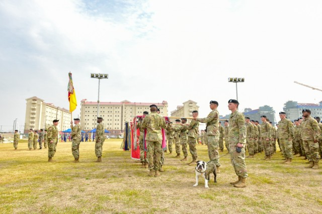 CAMP HUMPHREYS, Republic of Korea - Leaders from the 3rd Armored Brigade Combat Team, 1st Armored Division uncase battalion colors during a transfer-of-authority ceremony, at Camp Humphreys, October 22, with Pvt. Tank Chester, ABCT mascot, stands proud. 3rd ABCT will serve as the rotational tank brigade under the 2nd Infantry Division/ROK-U.S. Combined Division. This marks the first time that 1AD Soldiers have deployed to Korea. (U.S. Army Photo by Mr. Pak, Chin U., 2ID/RUCD Public Affairs)