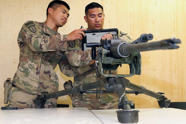 Sgt. Roque Torres, 1st Security Force Assistance Brigade, operates a M2A1 50-cal. machine gun while Sgt. Kim Yoonam shoots video at Forward Operating Base Lightning, Afghanistan, July 26. (Photo by Maj. Matt Fontaine, 1st SFAB Public Affairs)
