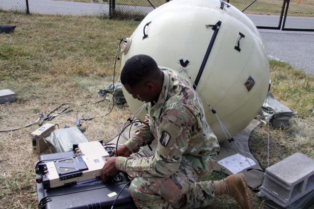Combat Cameraman Spc. Christopher Bellafant tests a data transmission system as part of tactical digital media training at Aberdeen Proving Ground, Md., Oct. 2018. The U.S. Army Network Cross-Functional Team and the U.S. Army Program Executive Office Command Control Communications-Tactical recently evaluated Rapid Innovation Fund proposals for two radio technologies that could help Soldiers in the field.