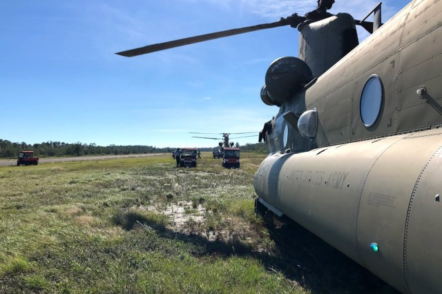 New York Army National Guard CH-47 Chinook helicopters from Company B, 3rd Battalion, 126th Aviation offload a 12-person search and rescue team and all-terrain vehicles to a location in Florida's Wakulla County October 12 following the impact of Hurricane Michael. The New York Army National Guard crews deployed 11 personnel and two aircraft to support the Florida Guard's 1st Battalion, 111th Aviation Task Force. Crews flew for three days, transporting 32, 240 pounds of cargo before returning to their flight facility in Rochester, N.Y. October 17.