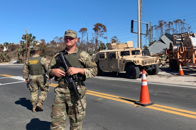 Soldiers assigned to Company D., 1st Battalion, 124th Infantry Regiment direct vehicles at a checkpoint in Mexico Beach, Fla following Hurricane Michael, October 21, 2018.