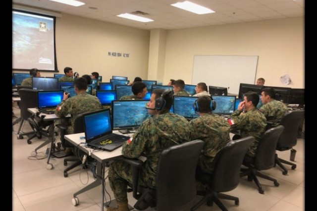 Cadets from Chile's Bernardo O'Higgins Military Academy experience technology day at Fort Benning. The cadets had hands-on experience at Clarke Simulations Center operating the Virtual Battlespace 3 and the Reconfigurable Vehicle Simulator.