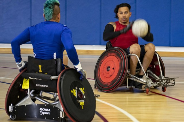 U.S. Army Retired Staff Sgt. Joel Rodriguez, right, catches a pass and looks to make his next move at wheelchair rugby training during the Team U.S. Training Camp at Port Hueneme, Calif.