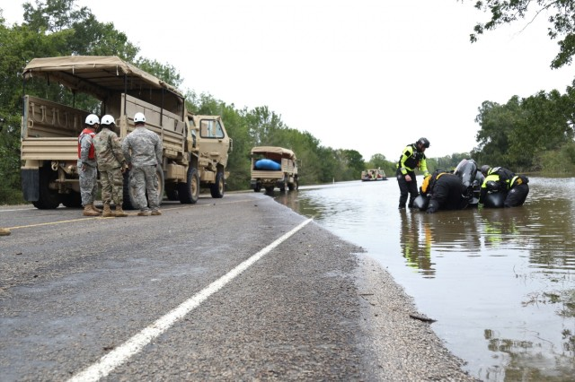 Texas National Guardsmen and local flood-response teams prepare to search for civilians in need in flooded areas outside of Huntsville, Texas, Oct. 18, 2018.  Texas Guardsmen worked alongside emergency first responders to help Texans in need during severe flooding.