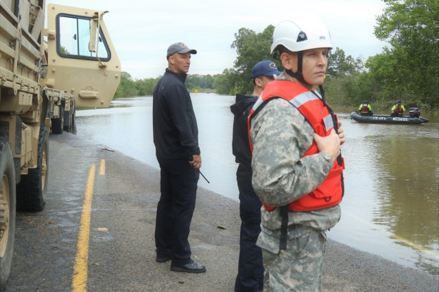 949th Brigade Support Battalion's flood-response Task Force Commander, 1LT Brendon Isenhower, alongside local flood-response teams, coordinate the launching of rescue vehicles near Huntsville, Texas, Oct. 18, 2018. Texas Guardsmen worked alongside emergency first responders to help Texans in need during severe flooding.