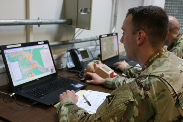 Sgt. Nicholas Maxim, acting as a member of the opposing force, builds and launches a simulated drone swarm during Exercise Dynamic Front 18 at the Joint Multinational Simulations Center, Grafenwoehr, Germany, in March. The right investments in modeling and simulation can save program managers money and time by turning up anomalies and problems early.