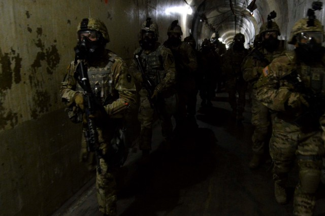 Soldiers perform evacuation procedures at Fort Hood's underground training facility Oct. 18. The training is part of a week-long training teaching Soldiers how to fight, win and survive in a dense urban terrain.