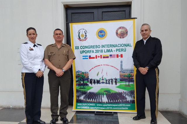From left to right, Brig. Gen. Dustin A. Shultz, Commanding general of the 1st Mission Support Command, U.S. Army Reserve-Puerto Rico, Brig. Gen. Moises Chavez, Commander of the Replacement and Mobilization Command of the Peruvian Army, and brig. Gen. retired Fernando Fernandez, President of the Pan American Association of Reserve Officers of the Armed Forces and former Commanding general of the 1st Mission Support Command, pose for a photo during the 20th Congress of the Organization in Lima, Peru, 16-20 Oct. 2018.