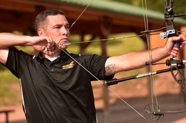 Staff Sgt. Ryan McIntosh draws his bow and takes aim at the target during archery practice. McIntosh is competing in the 2018 Invictus Games held in Sydney, Australia.